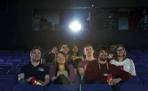 Students watching a film in the cinema