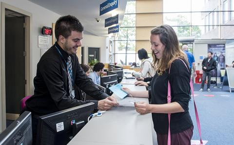 Student Services representative helping a student