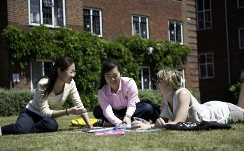 Students studying outside on campus