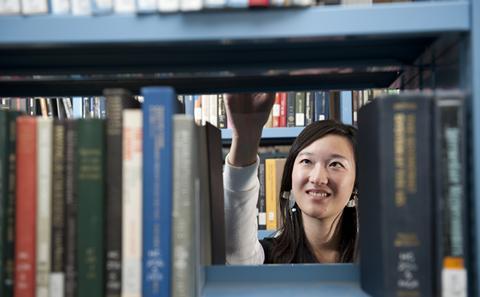 student and bookshelves