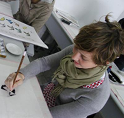 Graphic Arts student Beth Salter tries Chinese ink painting