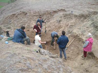 MRes and PhD students excavate a dinosaur skeleton at the Borborek site in Transylvania on our research group fieldtrip 2013