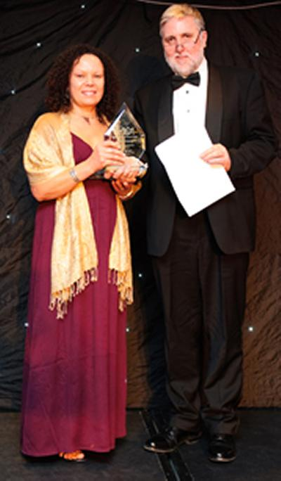 June Crump receiving her award from Tony Acland