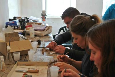 University of Southampton students (from left) Chris Laurent, Zoe Holbrook and Tracy Vorisek prepare fossils at the Sebes Municipal Museum