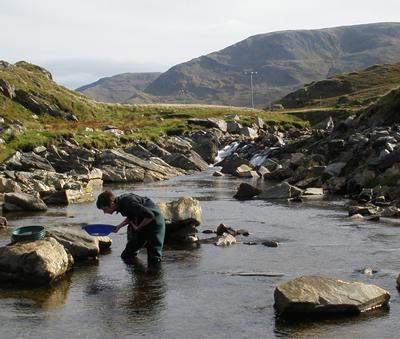 Dr Chris Standish panning for gold in Ireland.