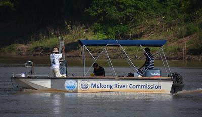 Researchers on Mekong River Commission boat