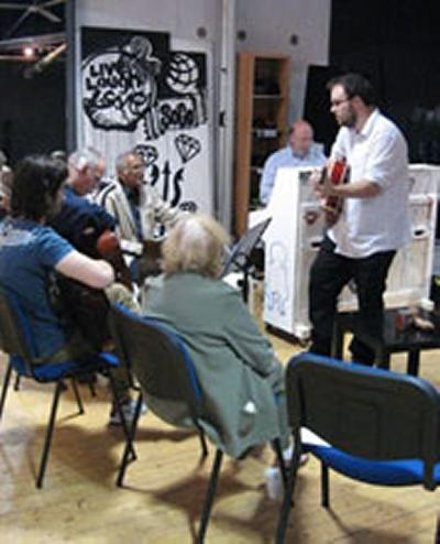 Dr Ben Oliver (guitar) and Professor David Nicholls leading the Musical Building Block workshop