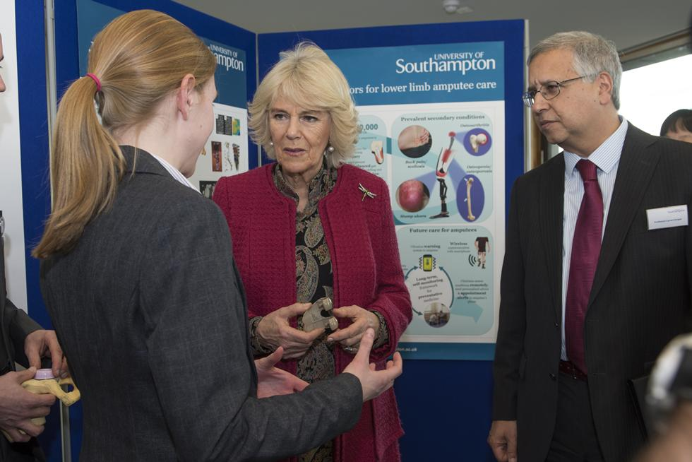 The Duchess of Cornwall talking with Katy Rankin and Professor Cyrus Cooper