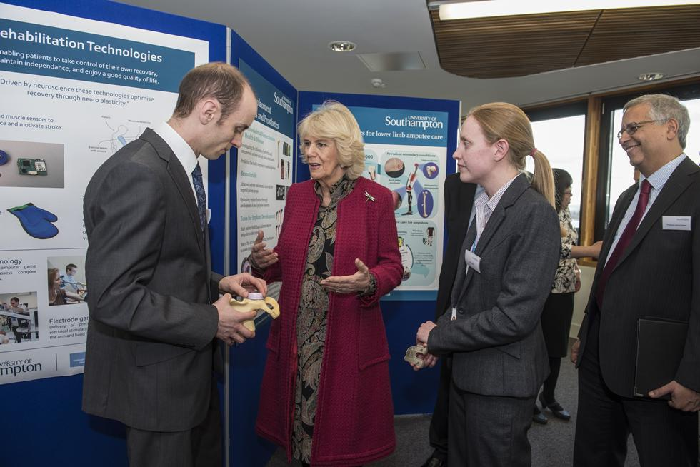 The Duchess of Cornwall talking with Dr Alex Dickinson and Katy Rankin
