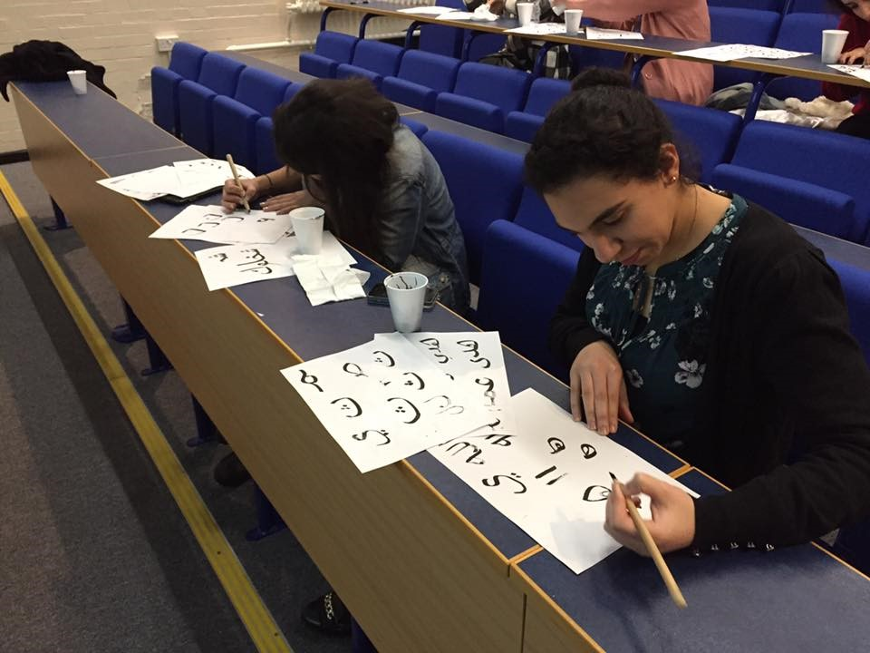 Students at the University of Southampton try their hand at calligraphy.