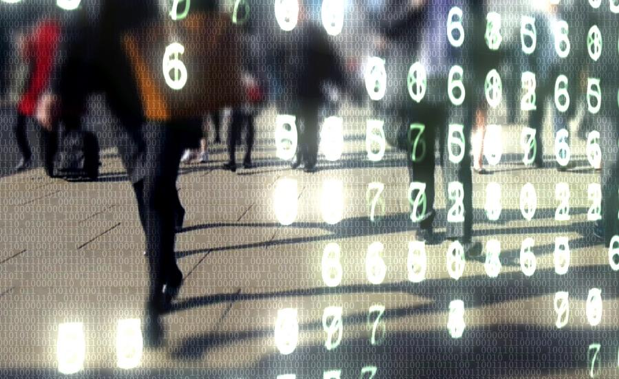 computer code overlaying the public walking across the street